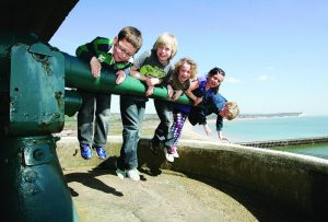 children hanging on a gun at newhaven fort